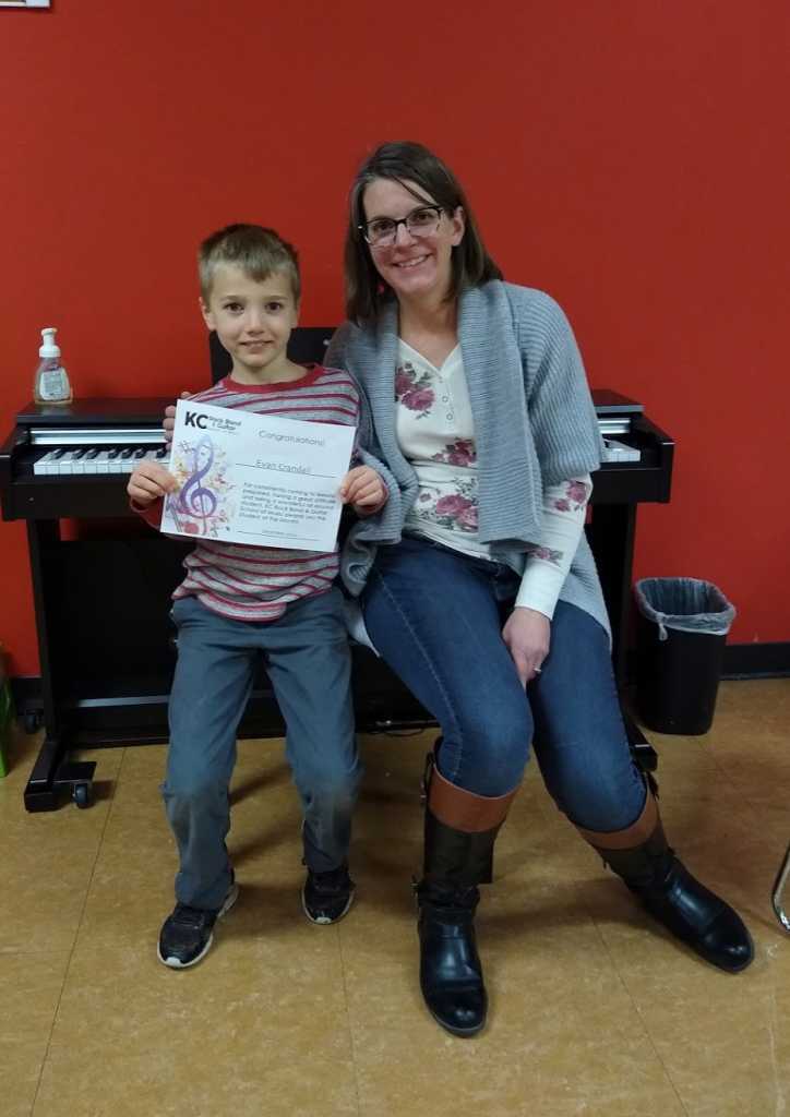 Text Box: Student of the Month – Evan Crandall Evan Crandall has been a KCRB piano student for three years, first with Karren, and currently with Sara.  He loves to play and is always ready for a challenge. Way to go, Evan, an your consistent progress and great music making!  Here's a little about Evan: Age and grade: 8 years old, 2nd grade. What do you like about piano? It has the more notes than any other instrument, and I like hearing the notes. Favorite song learned so far: Linus & Lucy Musical goals: Play piano for 10 years! Or maybe 5. Advice for new musicians: It takes awhile to get used to a new instrument.  If it's hard at first, don't worry. You'll get it in a few tries.